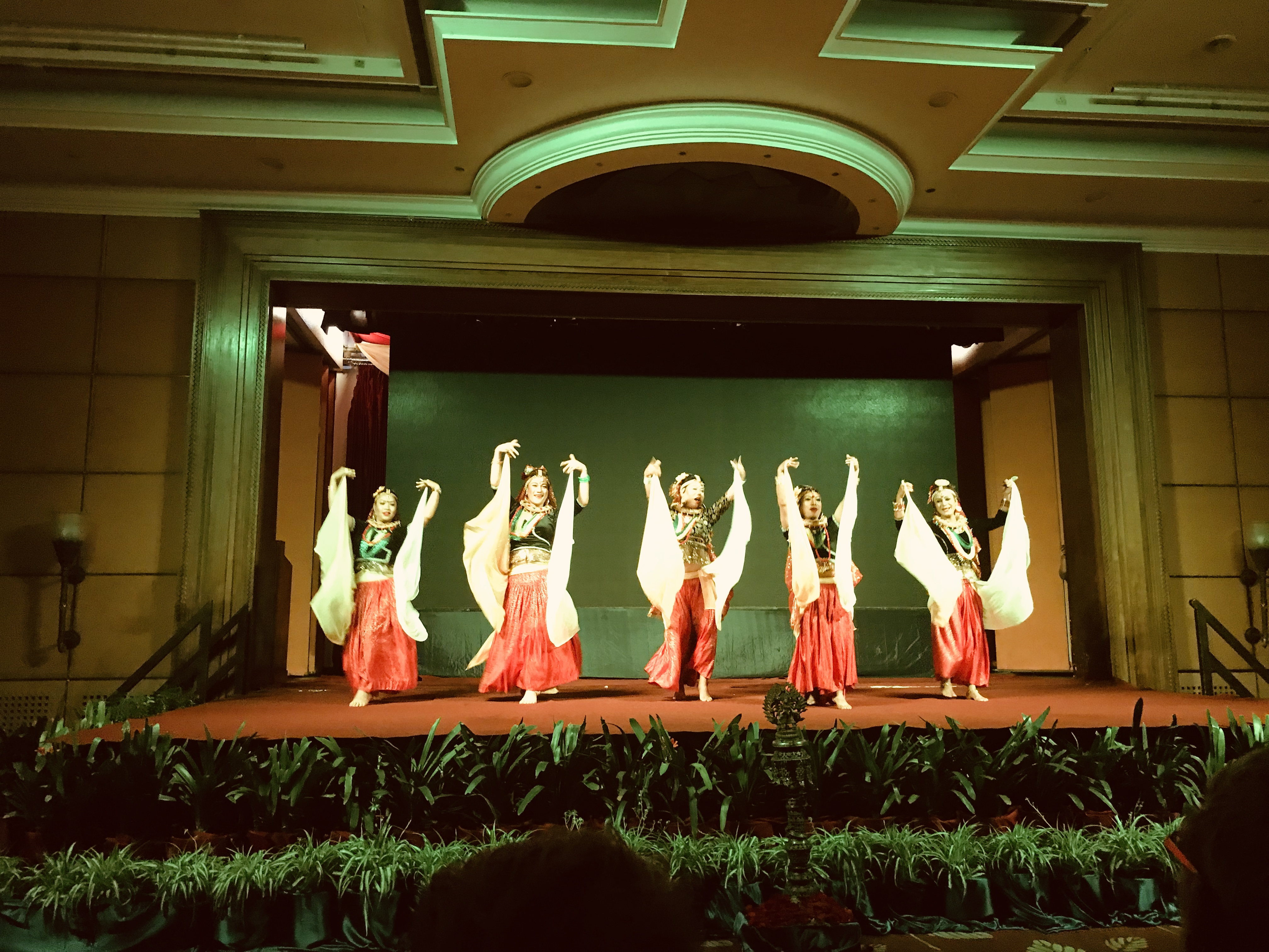 5 maruni dancers on the stage with arms in the air